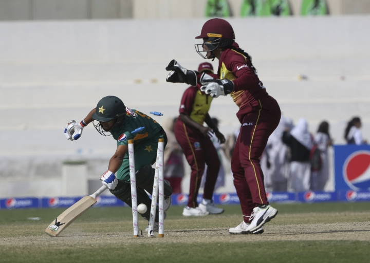 Pakistan's batsman Nida Dar runout as West Indies wicketkeeper Kycia Knight during the first Twenty20 in Karachi, Pakistan, Thursday, Jan. 31, 2019. West Indies women team beat Pakistan by 71 runs to take 1-0 lead in the three-match series. (AP Photo/Fareed Khan)