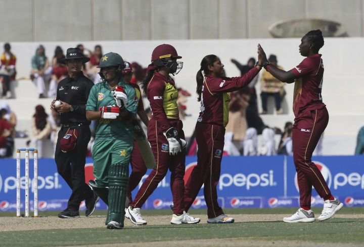 West Indies players celebrate the dismissal of Pakistan Iram Javed during the first Twenty20 in Karachi, Pakistan, Thursday, Jan. 31, 2019. West Indies women team beat Pakistan by 71 runs to take 1-0 lead in the three-match series. (AP Photo/Fareed Khan)