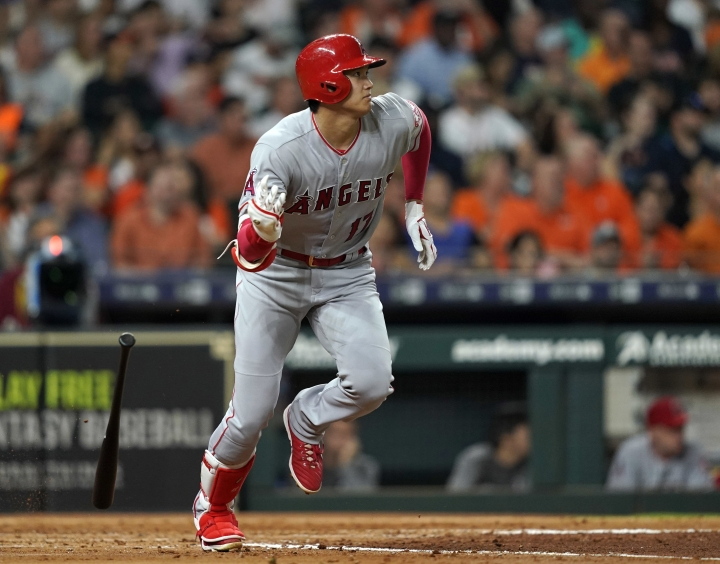 FILE - In this Sept. 21, 2018, file photo, Los Angeles Angels' Shohei Ohtani lines out against the Houston Astros during the fourth inning of a baseball game in Houston. Ohtani has been medically cleared to resume full strength training on his right arm following Tommy John surgery, although he will not be ready to hit for the Angels by opening day. Angels general manager Billy Eppler provided a positive update Thursday, Jan. 31, on the recovery of his two-way star. (AP Photo/David J. Phillip, File)