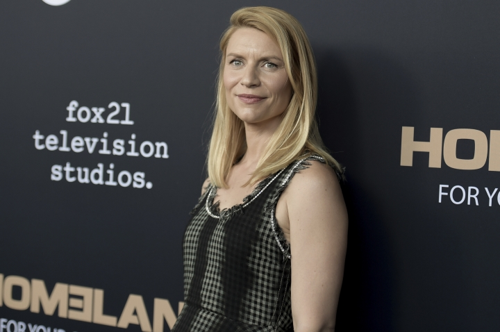 """FILE - In this June 5, 2018, file photo, Claire Danes attends the """"Homeland"""" FYC Event at the Writers Guild Theater in Beverly Hills, Calif. """"Homeland"""" fans will have to wait longer than expected for the start of the last season. Showtime said that the drama's planned return in June has been pushed back to fall. The complexity of production is the reason for the season-eight delay, Showtime entertainment president Gary Levine said Wednesday, Jan. 30, 2019. (Photo by Richard Shotwell/Invision/AP, File)"""