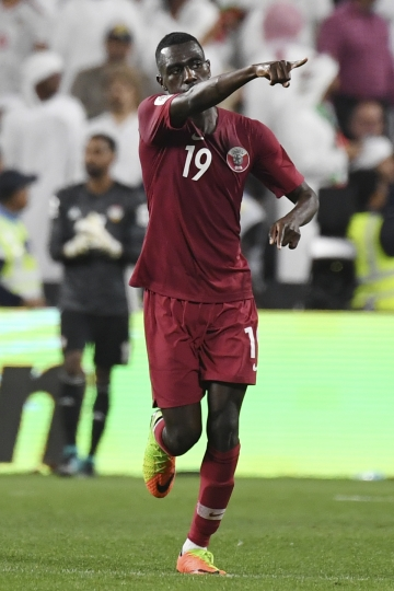 Qatar's forward Almoez Ali celebrates after scoring his side's second goal during the AFC Asian Cup semifinal soccer match between United Arab Emirates and Qatar at Mohammed Bin Zayed Stadium in Abu Dhabi, United Arab Emirates, Tuesday, Jan. 29, 2019. (AP Photo/Hassan Ammar)
