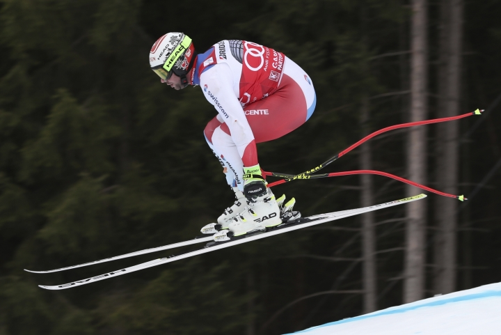 Switzerland's Beat Feuz is airborne during an alpine ski, men's World Cup downhill training, in Garmisch Partenkirchen, Germany, Friday, Feb. 1, 2019. (AP Photo/Andrea Solero)