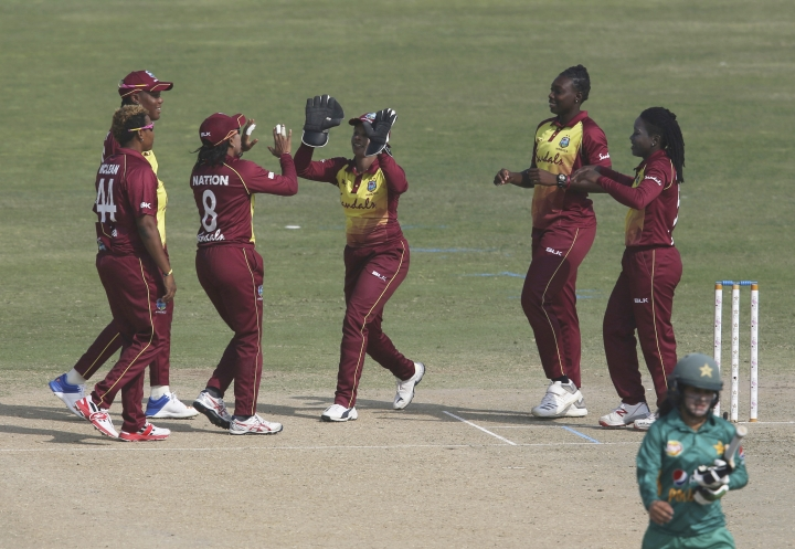 West Indies players celebrate the dismissal of Pakistan Javeira Khan during the second Twenty20 in Karachi, Pakistan, Friday, Feb. 1, 2019. West Indies women team won the first match against Pakistan to lead in the three-match series. (AP Photo/Fareed Khan)