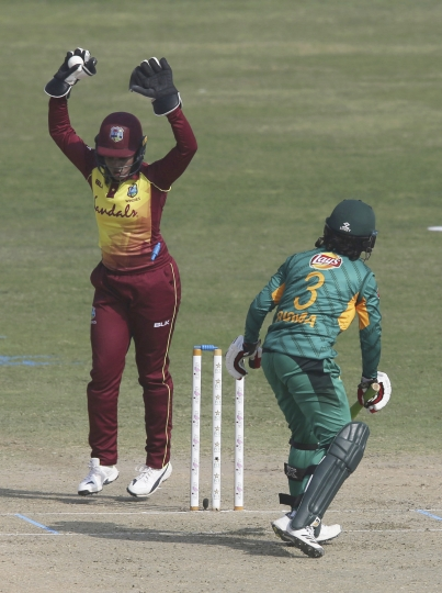 West Indies wicketkeeper Merissa Aguilleira celebrates the dismissal of Pakistan captain Bismah Maroof during the second Twenty20 in Karachi, Pakistan, Friday, Feb. 1, 2019. West Indies women team won the first match against Pakistan to lead in the three-match series. (AP Photo/Fareed Khan)