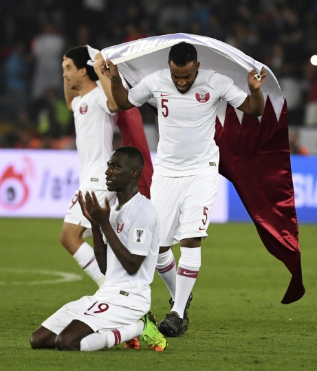 Qatar's forward Almoez Ali, front and his teammates celebrate after winning the AFC Asian Cup final match between Japan and Qatar in Zayed Sport City in Abu Dhabi, United Arab Emirates, Friday, Feb. 1, 2019. (AP Photo/Hassan Ammar)