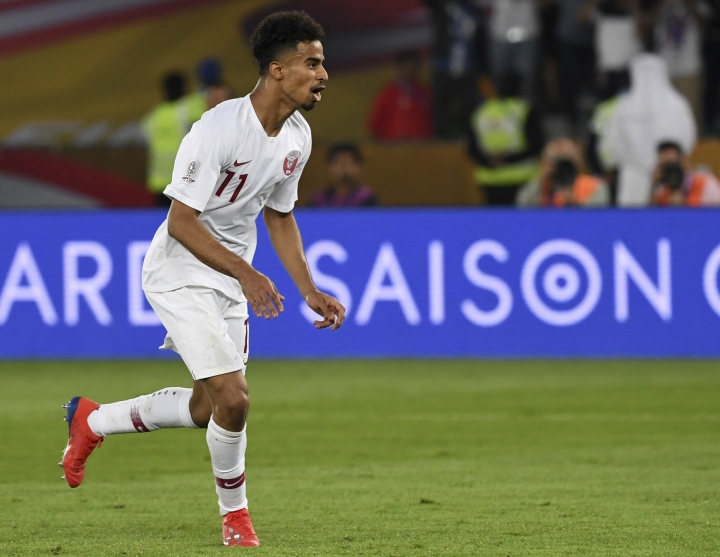 Qatar's forward Akram Afif runs to celebrate after scoring a penalty kick as his sides third goal during the AFC Asian Cup final match between Japan and Qatar in Zayed Sport City in Abu Dhabi, United Arab Emirates, Friday, Feb. 1, 2019. (AP Photo/Hassan Ammar)
