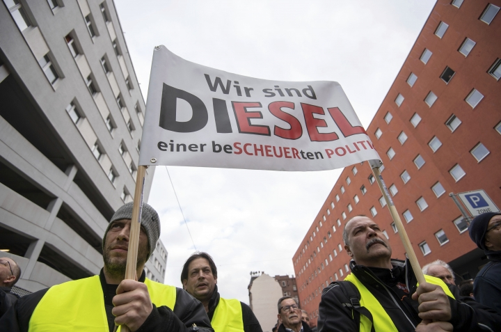 Demonstrators carry a banner during a protest in Stuttgart, Germany, Saturday Feb. 2, 2019. German police say around 800 people have demonstrated in Stuttgart against a new ban on driving older diesel cars. Stuttgart, a German auto industry center, on Jan. 1 became the first major German city to introduce a large-scale ban on driving older diesel cars with looser emissions standards. (Marijan Murat/dpa via AP)