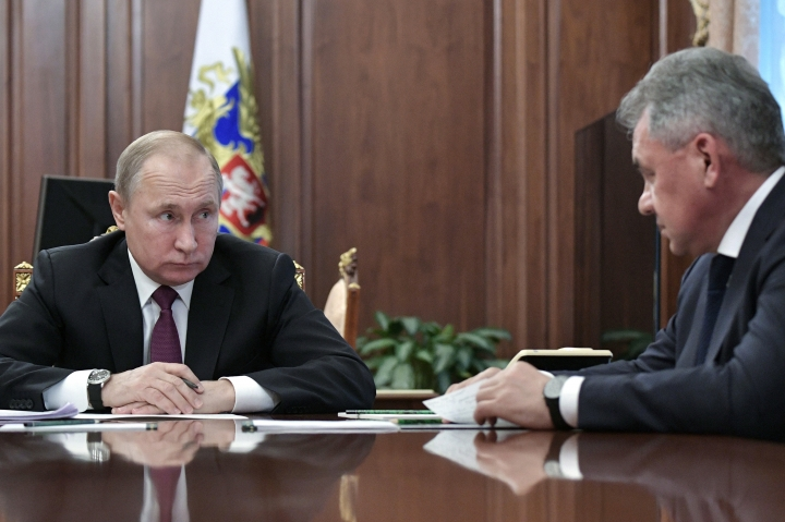 Russian President Vladimir Putin, left, speaks to Defense Minister Sergei Shoigu during a meeting in the Kremlin in Moscow, Russia, Saturday, Feb. 2, 2019. Putin said that Russia will abandon the 1987 Intermediate-Range Nuclear Forces treaty, following in the footsteps of the United States, but noted that Moscow will only deploy intermediate-range nuclear missiles if Washington does so. (Alexei Nikolsky, Sputnik, Kremlin Pool Photo via AP)