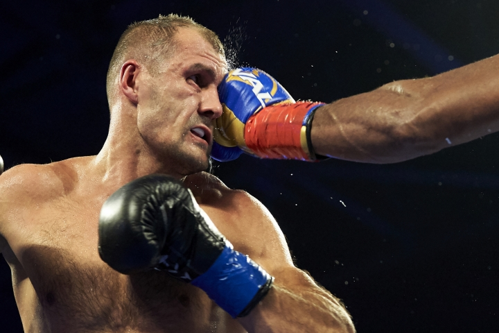 Sergey Kovalev, left, is hit by Eleider Alvarez during a WBO light heavyweight title boxing match, early Sunday, Feb. 3, 2019, in Frisco, Texas. (AP Photo/Cooper Neill)