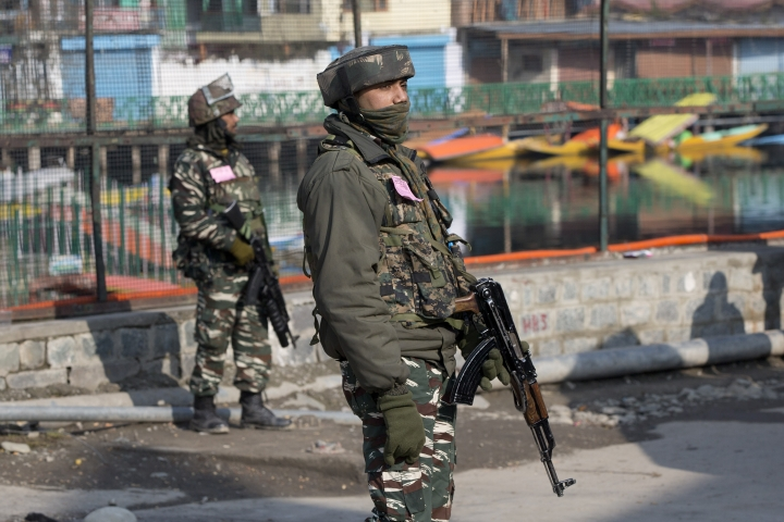 Indian paramilitary soldiers stand guard during a strike in Srinagar, Indian controlled Kashmir, Sunday, Feb. 3, 2019. India's prime minster is in disputed Kashmir for a daylong visit Sunday to review development work as separatists fighting Indian rule called for a shutdown in the Himalayan region. (AP Photo/Dar Yasin)