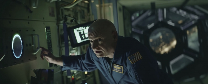 This undated image made from a video provided by Amazon shows a scene from the company's 2019 Super Bowl NFL football spot featuring Mark Kelly. Amazon pokes fun at itself as celebrities from Harrison Ford to astronaut twins Mark and Scott Kelly test products that didn't quite work out, including an electric toothbrush and a dog collar with Amazon's Alexa digital assistant. (Amazon via AP)