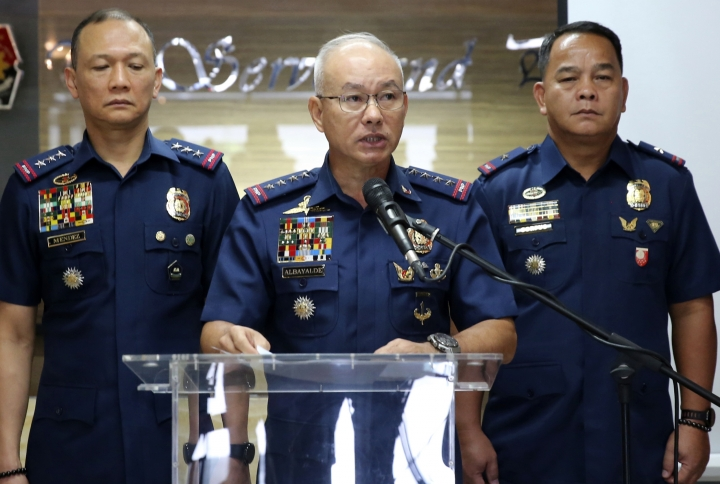 In this photo provided by Philippine National Police, Director General Oscar Albayalde, center, Chief of the Philippine National Police, announces at a news conference Monday, Feb. 4, 2019 at Camp Crame in suburban Quezon city northeast of Manila, Philippines, that five suspected Abu Sayyaf militants wanted for alleged involvement in the bombing of a church in southern Philippines have surrendered to authorities. Police chief Oscar Albayalde said Monday that the five will be charged with murder for their role in the Jan. 27 bombing of a Roman Catholic cathedral in Sulu province's Jolo town that killed 23 people and wounded about 100. Police say the suspects escorted the two suicide bombers around Jolo and to a meeting with the Abu Sayyaf commander accused of funding the attack. Police have said the two suicide bombers were Indonesians.(Philippine National Police via AP)