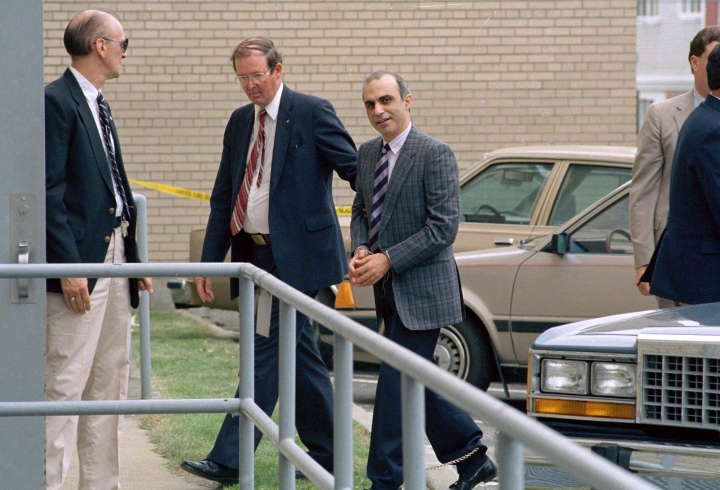 FILE - In this June 22, 1988 file photo, Walid Kabbani, right, one of three defendants of Lebanese descent from Montreal, Canada, is led into federal court in handcuffs in Burlington, Vt. Kabbani and the two others were caught smuggling the makings of a bomb into the U.S., on Oct. 23, 1987, in Richford, Vt. All three were convicted and sent to federal prison. (AP Photo/Toby Talbot, File)