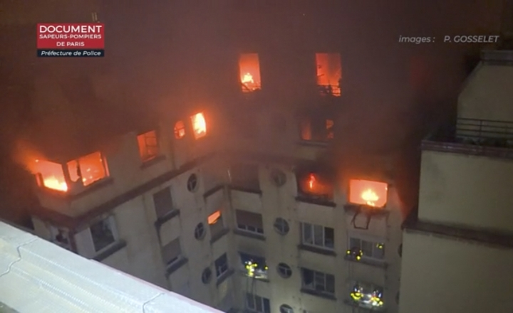 In this image taken from video released by the Paris Fire Dept., a fire rages through the top floors of an apartment building, Tuesday, Feb. 5, 2019, in Paris, France. A fire in a Paris apartment building has killed a number of people and sent residents fleeing to the roof or climbing out windows to escape. (Paris Fire Dept. via AP)