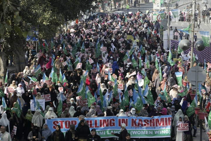 Supporters of Jamaat-e-Islami, a Pakistani religious party, attend a rally for Kashmir Day in Lahore, Pakistan, Tuesday, Feb. 5, 2019. Pakistan's prime minister and president on Tuesday offered support for rebels in the Indian part of the disputed Himalayan territory of Kashmir as the country staged rallies marking the annual Day of Solidarity with Kashmir. (AP Photo/K.M. Chaudary)