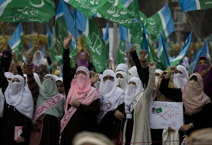 Supporters of Jamaat-e-Islami, a Pakistani religious party, attend a rally for Kashmir Day in Islamabad, Pakistan, Tuesday, Feb. 5, 2019. Pakistan's prime minister and president on Tuesday offered support for rebels in the Indian part of the disputed Himalayan territory of Kashmir as the country staged rallies marking the annual Day of Solidarity with Kashmir. (AP Photo/B.K. Bangash)