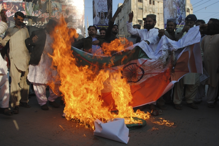 Pakistani protesters burn a representation of an Indian flag during a rally ahead of Kashmir Day in Hyderabad, Pakistan, Monday, Feb. 4, 2019. Pakistan will observe Kashmir Day on Feb. 5 in solidarity with Indian Kashmiris struggling for their independence. (AP Photo/Pervez Masih)