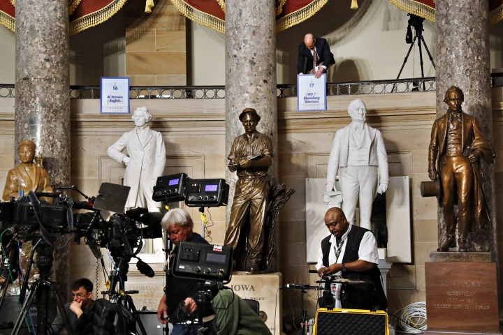 Television crews set up their equipment in Statuary Hall in the Capitol, Tuesday, Feb. 5, 2019, ahead of President Donald Trump's delivery of the State of the Union on Capitol Hill in Washington. (AP Photo/Jacquelyn Martin)
