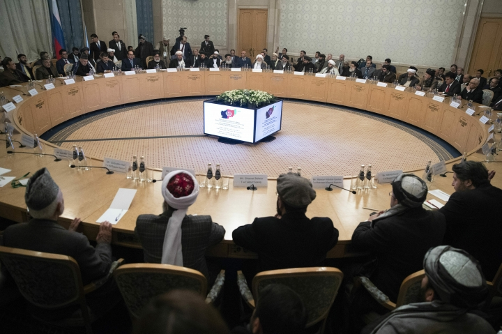 "Afghan politicians attend the ""intra-Afghan"" talks at the President Hotel in central Moscow. in Moscow, Russia, Tuesday, Feb. 5, 2019. The two-day meeting in the Russian capital is seen as another step in a process aimed at resolving Afghanistan's 17-year war, a process that has accelerated since the appointment last September of US peace envoy, Zalmay Khalilzad. (AP Photo/Pavel Golovkin)"