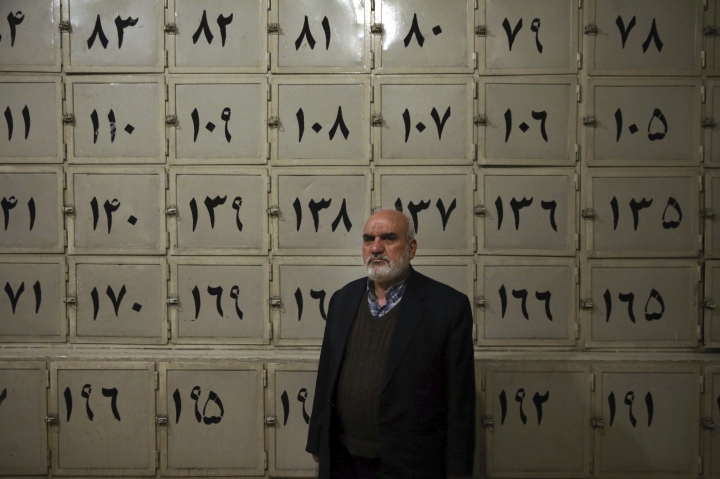 In this Monday, Jan. 7, 2019 photo, Ahmad Sheikhi, a 63-year-old former revolutionary, poses for a photo at a former prison run by the pre-revolution intelligence service, SAVAK, where he was once tortured, in Tehran, Iran. The former prison, now a museum, exhibits wax mannequins that silently portray the horrific acts of torture that once were carried out within its walls. As Iran marks the 40th anniversary of its Islamic Revolution and the overthrow of the shah, those who suffered torture at the hands of the police and dreaded SAVAK still bear the scars. (AP Photo/Ebrahim Noroozi)