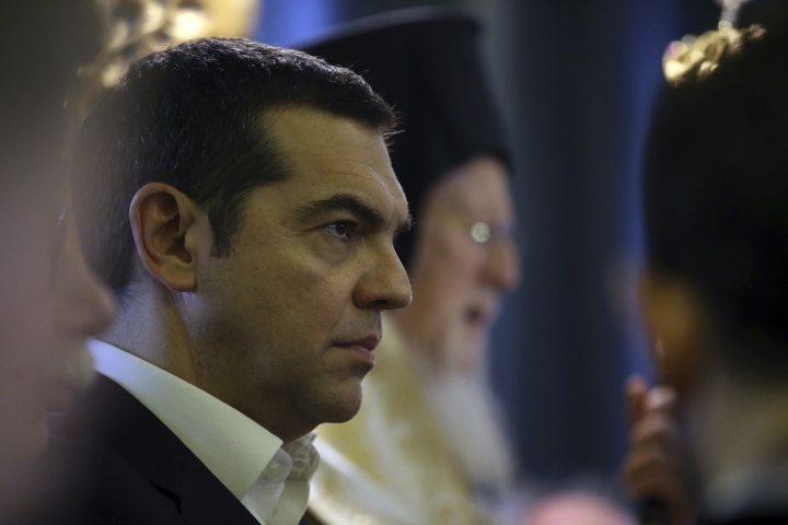 "Greece's Prime Minister Alexis Tsipras attends a church service during his visit at the Theological School of Halki, in Heybeli Island, near Istanbul, Wednesday, Feb. 6, 2019. The president of Turkey and the prime minister of Greece agreed Tuesday on the need to keep ""channels of dialogue"" open between their countries, which have come to the brink of war three times since the early 1970s and remain divided over an array of issues. (AP Photo/Emrah Gurel)"