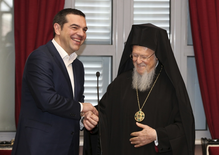 """Greece's Prime Minister Alexis Tsipras, left, and Ecumenical Patriarch Bartholomew I laugh during their visit at the Theological School of Halki, in Heybeli Island, near Istanbul, Wednesday, Feb. 6, 2019. The president of Turkey and the prime minister of Greece agreed Tuesday on the need to keep """"channels of dialogue"""" open between their countries, which have come to the brink of war three times since the early 1970s and remain divided over an array of issues. (AP Photo/Emrah Gurel)"""