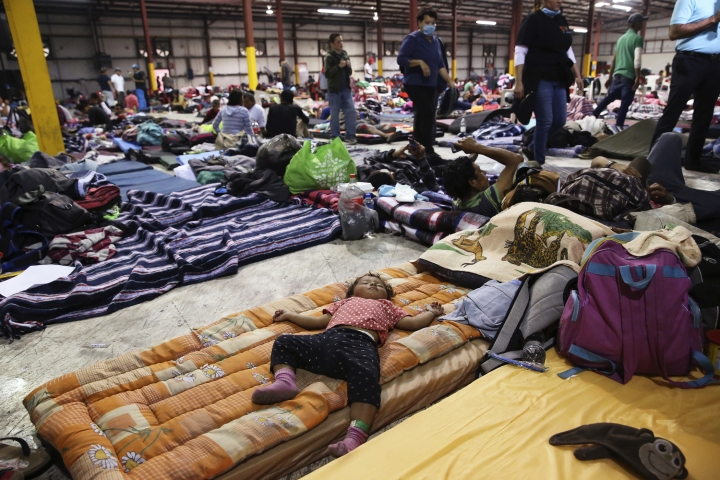 """One-year-old Julivet Fernando sleeps on a mattress at a sheltered in Piedras Negras, Mexico, Tuesday, Feb. 5, 2019. A caravan of about 1,600 Central American migrants camped Tuesday in the Mexican border city of Piedras Negras, just west of Eagle Pass, Texas. The governor of the northern state of Coahuila described the migrants as """"asylum seekers,"""" suggesting all had express intentions of surrendering to U.S. authorities. (Jerry Lara/The San Antonio Express-News via AP)"""