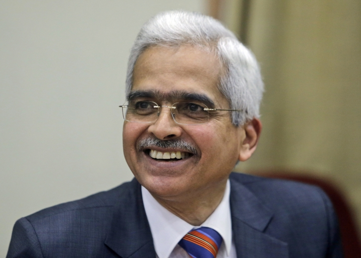 Governor of Reserve Bank of India Shaktikanta Das addresses a press conference in Mumbai, India, Thursday, Feb. 7, 2019. India's central bank has lowered its key interest rate by a quarter of a percentage point to 6.25 percent, a step that is expected to boost the economy. (AP Photo/Rajanish Kakade)