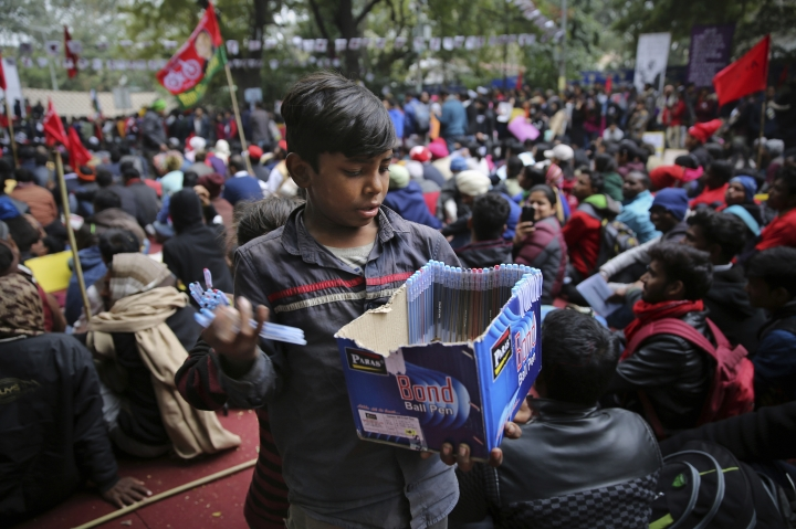 """A young boy sells pens at a protest rally by Indian students in New Delhi, India, Thursday, Feb. 7, 2019. The march called the """"Young India Adhikaar March,"""" or Young India Rights March, was held to demand the government address the problem of unemployment. (AP Photo/Altaf Qadri)"""