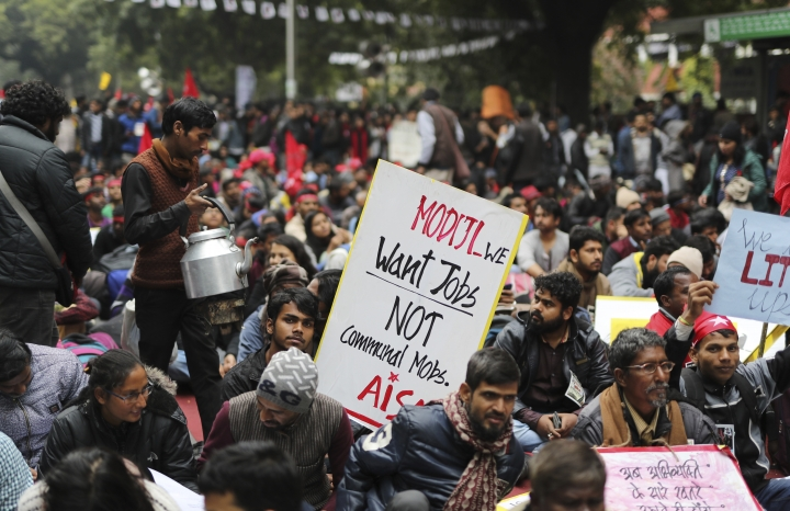 "An Indian roadside tea vendor sells tea to Indian students participating in a protest rally in New Delhi, India, Thursday, Feb. 7, 2019. The march called the ""Young India Adhikaar March,"" or Young India Rights March, was held to demand the government address the problem of unemployment. (AP Photo/Altaf Qadri)"