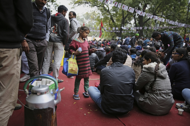 """A young girls sell pens at a protest rally by Indian students in New Delhi, India, Thursday, Feb. 7, 2019. The march called the """"Young India Adhikaar March,"""" or Young India Rights March, was held to demand the government take steps to address what they say is an unemployment crisis. (AP Photo/Altaf Qadri)"""