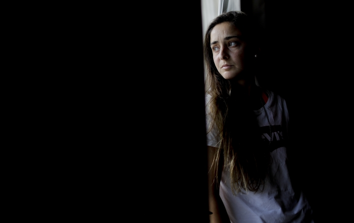 In this Jan. 31, 2019 photo, soccer player Macarena Sanchez poses for a photo at her home in Buenos Aires, Argentina. Sanchez is taking legal action against her club and the Argentine soccer association for not recognizing her as a professional player. (AP Photo/Natacha Pisarenko)