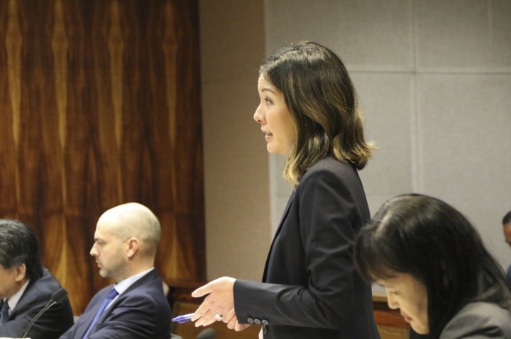 Hawaii deputy attorney general Kristen Sakamoto speaks during a hearing about Airbnb vacation rentals as Jacob Sommer, attorney for Airbnb, second from left, listens, Thursday, Feb. 7, 2019 in Honolulu. First Circuit Court Judge James Ashford denied Hawaii's move to compel Airbnb to hand over a decade of vacation rental receipts as the state examines whether hosts have been paying the equivalent of hotel and sales taxes. (AP Photo/Audrey McAvoy)