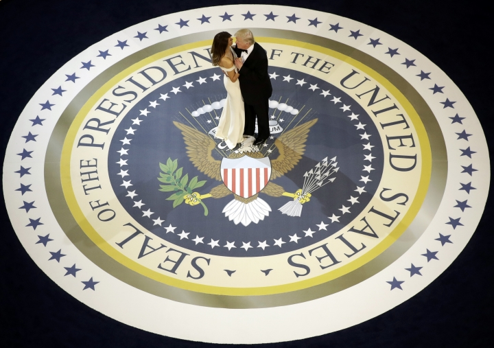 FILE - In this Jan. 20, 2017, file photo, President Donald Trump dances with first lady Melania Trump at The Salute To Our Armed Services Inaugural Ball. Federal prosecutors have cast a wide net in their investigation of President Donald Trump's inaugural committee, subpoenaing a smorgasbord of documents, including any addressing whether foreign nationals helped fund the $107 million celebration thrown to celebrate the Republican's ascent to the White House. (AP Photo/Evan Vucci, File)