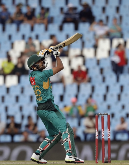 Pakistan's batsman Babar Azam watches his shot during the third T20 cricket match between South Africa and Pakistan at the Centurion Park in Pretoria, South Africa, Wednesday, Feb. 6, 2019. (AP Photo/Themba Hadebe)
