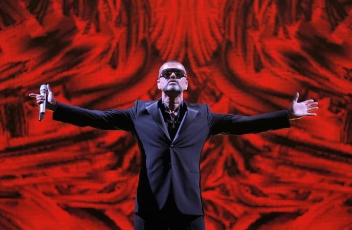 """FILE - In this Sept. 9, 2012 file photo, British singer George Michael performs at a concert to raise money for the AIDS charity Sidaction, during the Symphonica tour at Palais Garnier Opera house in Paris, France. Artworks collected by George Michael before his death in 2016 are going up for auction. Christie's is selling the music star's collection, including pieces by Damien Hirst, Tracey Emin and Sarah Lucas _ members of the """"Young British Artists"""" generation who, like Michael, shook up Britain's creative scene in the 1980s and 90s. (AP Photo/Francois Mori, File)"""