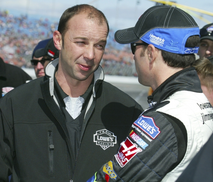 FILE - In this Feb. 12, 2006, file photo, NASCAR crew chief Chad Knaus, left, and driver Jimmie Johnson talk during qualifying runs at Daytona International Speedway in Daytona Beach, Fla. Knaus got his first big break at Hendrick Motorsports when he was picked to build a team from scratch around a rookie driver who had yet to prove he belonged at NASCAR's top level. The driver was Jimmie Johnson. (Nigel Cook/The Daytona Beach News-Journal via AP)