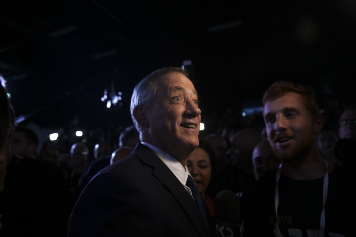 """FILE - In this Jan. 29, 2019, file photo, retired Israeli military chief Benny Gantz reacts at the official launch of his election campaign for the April 2019 elections, in Tel Aviv. Gantz has burst onto the Israeli political scene as the great hope of the country's shrinking """"peace camp"""" with a message that is anything but dovish. The retired general, who hopes to topple Prime Minister Benjamin Netanyahu in April 9 elections, talks tough. In today's Israel, his ready-to-rumble rhetoric appears to be the only way to topple the long-serving Netanyahu. (AP Photo/Oded Balilty, File)"""