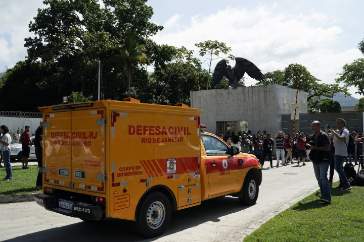 A civil defense coroners truck arrives at the Flamengo soccer club training complex after a deadly fire at the facility in Rio de Janeiro, Brazil, Friday, Feb. 8, 2019. A fire tore through the sleeping quarters of the Flamengo soccer club development league, one of Brazil's most popular professional soccer clubs, killing several people who were most likely players and injuring others, authorities said. (AP Photo/Leo Correa)