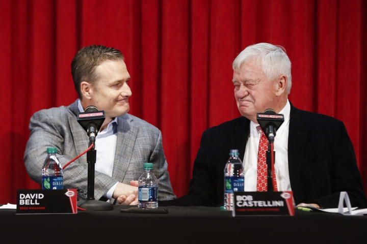 FILE - In this Oct. 22, 2018, file photo, Cincinnati Reds manager David Bell, left, shakes hands with team CEO Bob Castellini, during a news conference, in Cincinnati. The Reds have been one of the busiest teams in the offseason, remaking their starting rotation and their everyday lineup through a series of trades. First-year manager David Bell has to figure out how it all fits as the Reds begin their push to escape the basement of the NL Central. (AP Photo/John Minchillo, File)