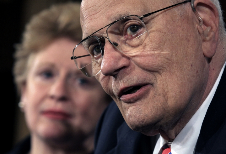 FILE- In this Sept. 24, 2008 file photo, House Energy and Commerce Committee Chairman Rep. John Dingell, D-Mich., right, accompanied by Sen. Debbie Stabenow, D-Mich., meets with reporters on Capitol Hill in Washington. Dingell, the longest-serving member of Congress in American history who mastered legislative deal-making and was fiercely protective of Detroit's auto industry, has died at age 92. Dingell, who served in the U.S. House for 59 years before retiring in 2014, died Thursday, Feb. 7, 2019, at his home in Dearborn, said his wife, Congresswoman Debbie Dingell.(AP Photo/Lauren Victoria Burke, File)