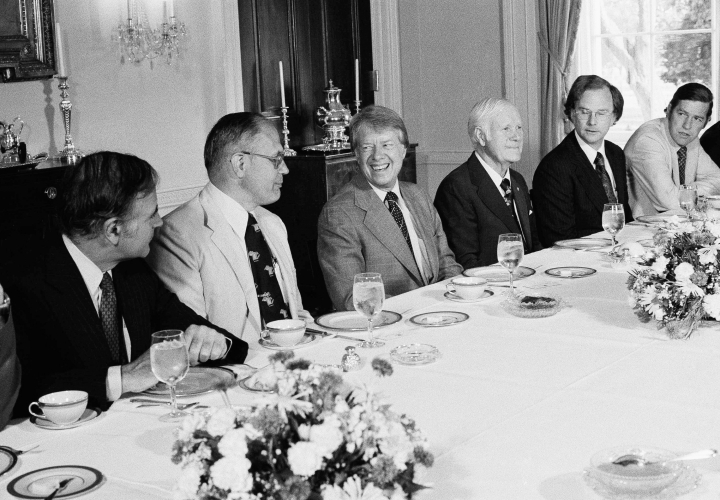 FILE - In this June 2, 1977 file photo, President Jimmy Carter hosts a breakfast in the Family Dining Room of the White House in Washington for House Subcommittee members on Energy and Power. From left are Rep. John M. Murphy (D-N.Y.), Rep. John Dingell (D-Mich.), President Carter, Rep. Harley Staggers (D-W Va.), Rep. Andrew Maguire (D-N.J.), and Rep. Timothy Wirth (D-Colo.). Dingell, the longest-serving member of Congress in American history who mastered legislative deal-making and was fiercely protective of Detroit's auto industry, has died at age 92. Dingell, who served in the U.S. House for 59 years before retiring in 2014, died Thursday, Feb. 7, 2019, at his home in Dearborn, said his wife, Congresswoman Debbie Dingell. (AP Photo/Charles Harrity, File)