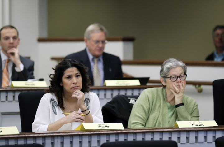 Rep. Monica Stonier, D-Vancouver, lower left, and Rep. Laurie Jenkins, D-Tacoma, right, listen Friday, Feb. 8, 2019, during a public hearing before the House Health Care & Wellness Committee at the Capitol in Olympia, Wash. Amid a measles outbreak that has sickened people in Washington state and Oregon, lawmakers heard public testimony Friday on a bill that would remove parents' ability to claim a philosophical exemption to opt their school-age children out of the combined measles, mumps and rubella vaccine. (AP Photo/Ted S. Warren)