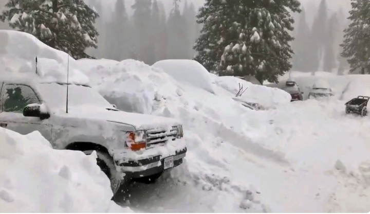 This Tuesday, Feb. 5, 2019 photo from video by Joel Keeler shows vehicles buried in the parking lot of the snowed-in Montecito Sequoia Lodge in Kings Canyon National Park in California's Sierra Nevada. More than 120 visitors and staff who became snowbound in the Sierra Nevada resort for five days have been freed. The U.S. Forest Service says snow trapped the guests and staff at the lodge starting Sunday following a storm. They couldn't get out until Thursday night, Feb. 7, 2019. (Joel Keeler via AP)
