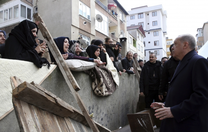 """Turkey's President Recep Tayyip Erdogan speaks to people as he visits the site of a collapsed building in Istanbul, Saturday, Feb. 9, 2019. Erdogan says there are """"many lessons to learn"""" from the collapse of a residential building in Istanbul where at least 17 people have died.(Presidential Press Service via AP, Pool)"""
