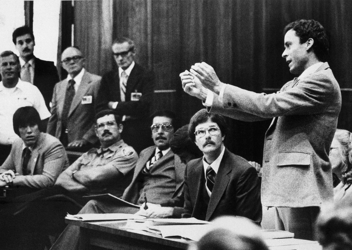 FILE - In this Monday, June 25, 1979 file photo, Ted Bundy presents a motion during his murder trial in Miami. He complained that he could not work on his defense in a 9- by 7-foot cell. Bundy is charged with clubbing two young women to death in a sorority house in Tallahassee. (AP Photo)