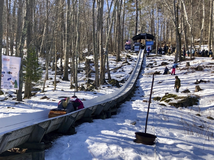 A participant competes in the 29th annual National Toboggan Championships at the Camden Snow Bowl Saturday, Feb. 9, 2019, in Camden, Maine. (Lauren Abbate/The Bangor Daily News via AP)