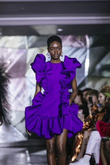 The latest fashion creation from Christian Siriano is modeled during New York Fashion Week, Saturday, Feb. 9, 2019, in New York. (AP Photo/Kevin Hagen)