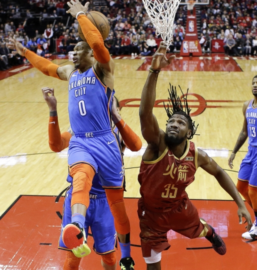 Oklahoma City Thunder guard Russell Westbrook (0) and Houston Rockets forward Kenneth Faried, right, vie for a rebound during the first half of an NBA basketball game, Saturday, Feb. 9, 2019, in Houston. (AP Photo/Eric Christian Smith)