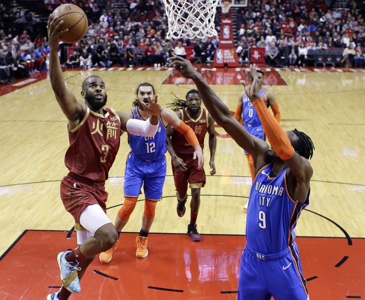 Houston Rockets guard Chris Paul (3) drives to the basket as Oklahoma City Thunder forward Jerami Grant (9) defends during the first half of an NBA basketball game, Saturday, Feb. 9, 2019, in Houston. (AP Photo/Eric Christian Smith)